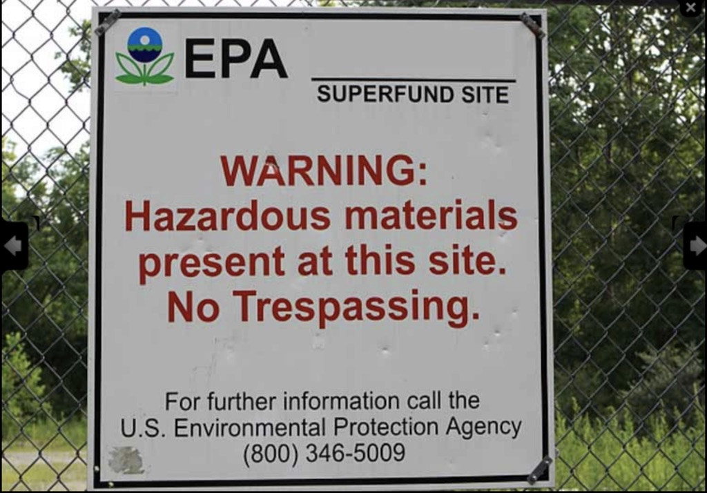 EPA superfund site warning sign on a chainlink fence