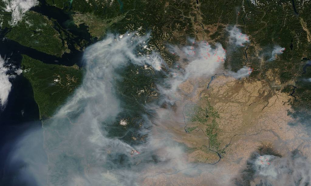Aerial image of Washington on August 22, 2015 showing the Puget Sound region covered in smoke from wildfires in Eastern Washington. Photo: NASA