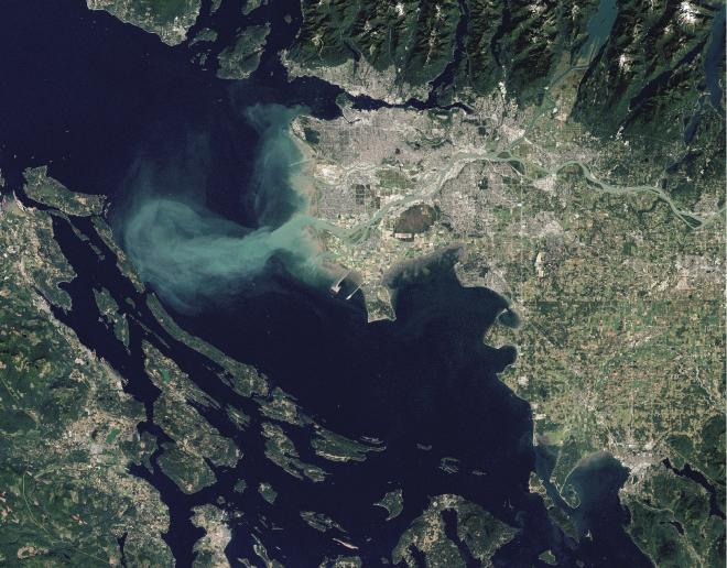 Sediment-laden water from the Fraser River enters the Straight of Georgia (page 34). Photo: NASA Earth Observatory