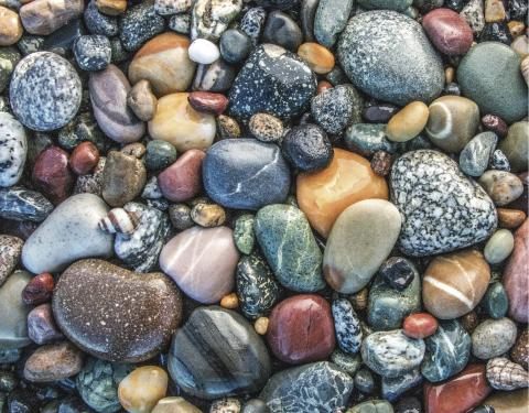 Surf-polished stones at Birch Bay State Park (page 12). Photo: Wendy Shattil/Bob Rozinski