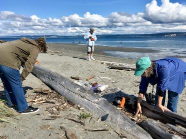 Sheryl and Todd Ramsey with Gretchen Waymen-Palmer in the wood zone of Point No Point beach. Photo: Eric Wagner