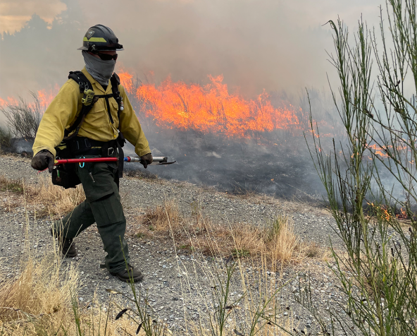 A firefighter monitors a controlled burn near Joint Base Lewis-McChord in Washington. Photo by Jeff Rice.
