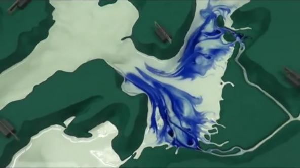 Blue dye is used to illustrate currents in the Puget Sound Model at the UW School of Oceanography. Video screenshot: copyright Richard Strickland and Encyclopedia of Puget Sound
