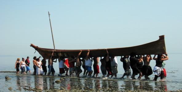 Coast Salish Canoe Journey 2009 landing in Pillar Point; photo by Carol Reiss, USGS