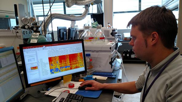 Dr. Ed Kolodziej analyzes mass spectrometry data in his lab at the Center for Urban Waters. Photo: Kris Symer