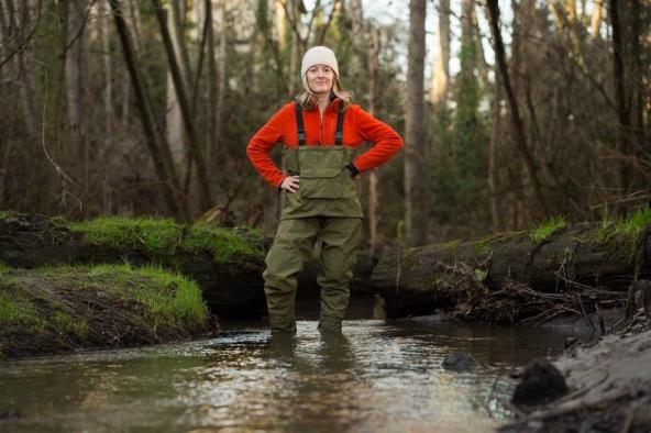 Dr. Jenifer McIntyre, an Aquatic Ecotoxicologist, standing in a stream. Photo courtesy: Washington State University
