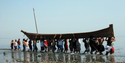 Coast Salish Canoe Journey 2009 landing in Pillar Point; photo by Carol Reiss, USGS