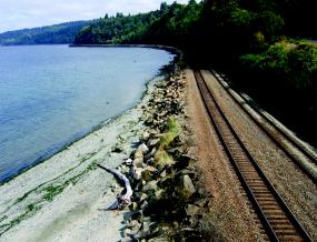 Shoreline armoring along railroad
